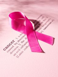 cancer definition with breast cancer ribbon